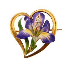 "A lovely Art Nouveau 14K yellow gold brooch in the form of an iris blossom superimposed over a sinous heart-shaped outline by Krementz, ca. 1910. The iris is beautifully finished in thick, colorful enamels, built up in layers for greater three-dimensionality. Leaves are translucent enamels, more typically seen in Krementz pieces. The center of the blossom features a row of bright, old European cut diamonds. The original clasp is marked ""14K"". The pin is unsigned, but is a known Krementz…"