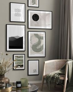 A gallery wall with art prints. A cane armchair with a muted green throw and a dark marble top round table with decor set the organic but eclectic vibe. Image via Desenio. Poster On, Poster Wall, Desenio Posters, Industrial Wall Art, Beige Background, Hanging Art, Wall Art Designs, Slovenia, Arches