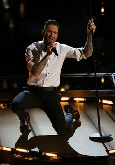 On fire! Adam Levine and his band Maroon 5 were the first musical act to kick off the ceremony