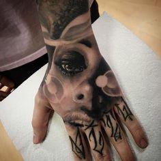 Hand tattoo by Tom Farrow