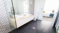 Take another look around Darren and Dee's sophistcated and stylish ensuite.