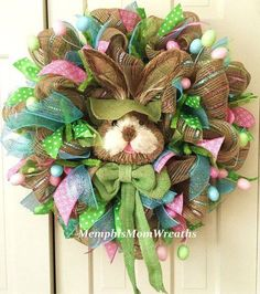 Fun colors of Easter on decomesh wreath with a bunny to make you smile.