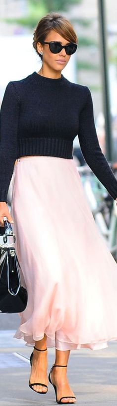 Jessica Alba wears a whisper pink maxi skirt with black crew neck shirt and strappy sandals