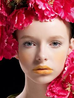 Angela Filippova and her porcelain skin with glossy yellow lips.