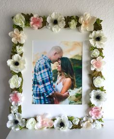 This is a gorgeous floral 11 x 14 floral frame that has lovely white matting and fits an 8 x 10 photo. You will receive the exact frame as above. This frame is adorned with beautiful silk flowers (including anemones), leaves, and detailed greenery buds. The colors are white, cream, peach, pink, and beautiful rustic greens. This would be the perfect addition to your wedding decor, a nursery, a fireplace mantle, a shelf, or a gallery wall. The colors are sophisticated and sweet. It would also…