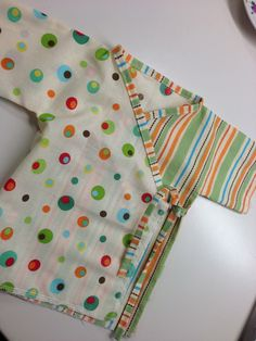 baby kimono gowns that are cut out and ready to sew
