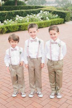 Ring Bearers -- Khakis + Suspenders + Bowties + Sneakers -- Too cute! See the wedding here: http://www.StyleMePretty.com/california-weddings/2014/05/14/classic-elegant-pelican-hill-resort-wedding/ One Love Photo - onelove-photo.com - #smp