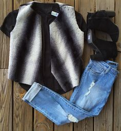 We are falling in love! ❤️ This adorable vest is perfect for layering and is sure to add style and warmth to any outfit! | Black & white vest $68 | Black tee $36 | Adele slouchy $84 | @Toms bootie $129 | #fallfavorites #fallstyle #vests #shopjuneandbeyond #juneandbeyond