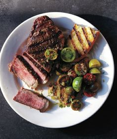 Steak With Baby Tomato Salad and Grilled Bread Yet another reason to love summer-ripe tomatoes: Their natural acidic juices can be whisked with olive oil and herbs for an easy, instant dressing. This entire feast is ready in 20 minutes flat.