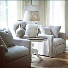 Neutral collection and table, and slipcovers;  all very restful.