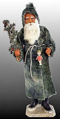 Father Christmas Santa Claus candy container, German, circa 1890s.