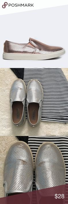 Steve Madden Ezeke Slip On Sneakers these silver slip on sneakers are great. They have been worn many times. Are a little scuffed. The white edge around the bottom is more of a cream color from all the use. Steve Madden Shoes Sneakers