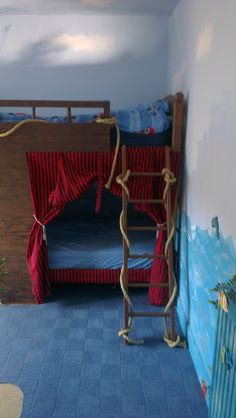 Ash's pirate ship bed! Just box off a wooden bunk bed with marine ply, paint with chocolate brown gloss then go over with Ronseal Paint & grain graining tool & darker gloss, add bannister rails cut up to the top beam, thick rope, red & black stripey material, a steering wheel & telescope, some seaweed etc & bada bing!