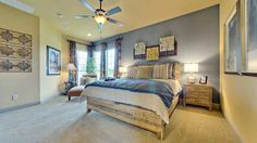 The #blue #colorblock #wall in this #master #bedroom provides a tranquil backdrop and contrasts the beautiful #wood #furniture and #neutral #tones.