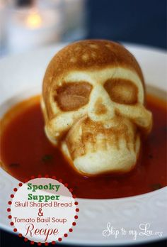 Homemade skull bread in tomato soup for a tasty and spooky Halloween #recipe #halloween skiptomylou.org