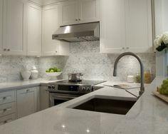 Kitchen, creamy white shaker kitchen cabinets, antique glass knobs hardware, granite counter tops, brushed nickel faucet, white carrara marble subway tiles backspalsh, breakfast bar