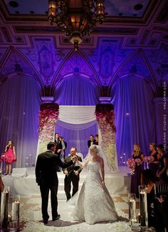 Morgan and Andrea taking their ceremonious walk in front of their stunning chuppah / Wedding of Morgan Pressel and Andrew at The Breakers in Palm Beach, FL / Photo by Maloman Studios