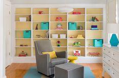 Mandarina Studio | Boston | Nursery | Interior Design | Contemporary | Colorful Baby Room | Builtin Toy Storage | Builtin Book Shelf | Gray Glider and Ottoman | Contemporary White Dresser | Fabric Toy Bins | Blue Contemporary Lamp | Yellow and Blue Nursery | Benjamin Moore Hawthorn Yellow