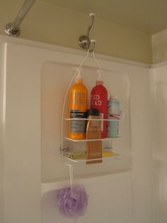 Organize your bathroom shower using a shower caddy on the opposite wall from the shower head.