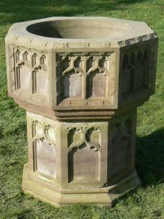 """An antique sandstone font, octagonal in shape and carved on all sides with gothic tracery and florets. It is well proportioned with a deep bowl draining vertically through the solid base. It could be used either as a feature urn for flowers or as a fountain and was formerly in a church in West Yorkshire.  19th Century  27"""" x 27"""" x 36"""" high  £1800"""