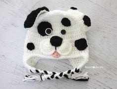"I had the urge to create another puppy hat but wanted to try different ""mouth"" design. And since I came across this black polka dotted shirt in a bag of hand-me-downs for my daughter, I just had to make a Dalmatian Dog to match  The basic pattern is the same as my Puppy Hat …"