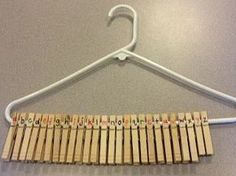 Number or alphabet clothes pins on a hanger. Not only would it strengthen their knowledge of numerical order, but it could simultaneously work on fine motor skills. Alphabet Activities, Literacy Activities, Educational Activities, Preschool Activities, Preschool Math, Kindergarten Math, Learning Centers, Kids Learning, Learning The Alphabet