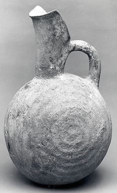 Spouted jug with raised concentric circles Period: Early Bronze Age II Date: ca. 2700–2400 B.C. Geography: Northwestern Anatolia Medium: Ceramic Dimensions: 8.27 in. (21.01 cm) Classification: Ceramics-Vessels Credit Line: Rogers Fund, 1960