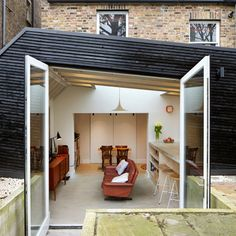 Fraher Architects' blackened timber extension for a keen cook Building Exterior, Building A House, Kitchen Extension Exterior, Residential Architecture, Interior Architecture, Architects London, Backyard Studio, Timber Structure, Space Interiors