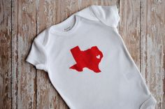 Pin for Later: Made in America! 50 Great Baby Gifts For All 50 States Texas Any Lone Star State baby would be proud to wear this Deep in the Heart of Texas onesie ($15).