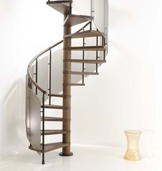 Interior Design Spiral Staircase And Log Spiral Staircase Also Space Saving Staircases For Small Homes Design And White Flooring Ideas An Elegant Brown Spiral Staircase With Solid Wood Flooring For The Minimalist Home Spiral Staircase Kits, Modern Staircase, Staircase Ideas, Spiral Staircases, Loft Spaces, Small Spaces, Living Spaces, Kerala, Home Stairs Design