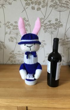 Meet Connie the Care-worker. Excited to share the latest addition to my #etsy shop: Hand Knitted Wine Bottle Cover - Care-worker Bunny Rabbit http://etsy.me/2oWYbY1 #housewares #homedecor #blue #birthday #mothersday #white #bedroom #winebottlecover #bottlecover