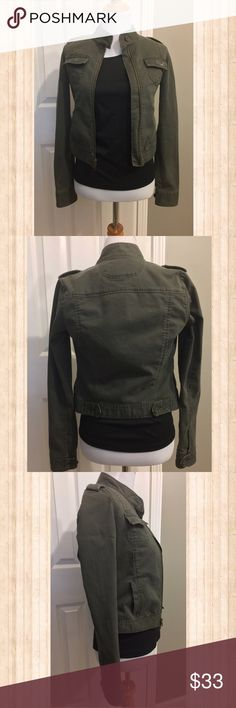 Chic Hollister Moto Jacket Super chic zip up army green with a hint of brown Hollister Moto Jacket.  Has two chest pockets as well as two hand pockets.  Also has double ended zipper as seen in picture three.  Has just the right amount of stretch for a perfect fit.  Only worn a couple of times.  Looks great with everything from skinny jeans to dresses! Hollister Jackets & Coats