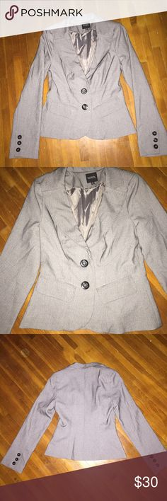 Gray Blazer Fitted gray Blazer with black button details and small shoulder pads. Very gently used! 100% polyester XOXO Jackets & Coats Blazers