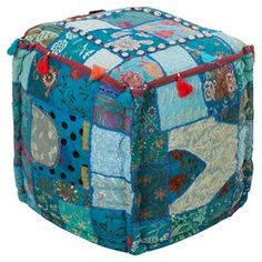 """Handmade eco-friendly cotton pouf with a patchwork design and tassel trim.  Product: PoufConstruction Material: 100% CottonColor: Light celadon, teal, blue corn, dark periwinkle and flamingo pinkFeatures: Made in IndiaDimensions: 18"""" H x 18"""" W x 18"""" DCleaning and Care: Blot stains"""