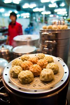 A set of mandu (Korean dumplings) are cooling and waiting to be eaten near Namdaemun Market. These bite-sized morsels of kimchi, vegetables, and meat can be found almost anywhere in Seoul. What's your favorite type of mandoo?