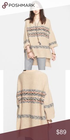 """Free People Fair Isle Tunic Free People Fair Isle Tunic. Size M/L. New with tag.  Very comfy and oversized!  A spacious tunic is soft and cozy in a tactile, mixed knit. The high/low split hem keeps the look free flowing and easy. - Crew neck - Long dolman sleeves - Striped - Side slits - Hi-lo hem - Knit construction - Approx. 29"""" shortest length, 41"""" longest length 89% alpaca, 11% nylon Free People Sweaters"""
