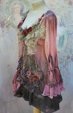 Whimsy baroque inspired cotton jacket or blouse, hand dyed ombre shades of salmon, peach, brown, gray, altered couture, richly embellished with intricate details. The neckline is adorned with old lace pieces-ecru, cream, dull gold, silk and tulle pieces; stitched, textured, and adorned with beading, lace, handmade wine rosebuds and hand beading. The hems are adorned with vintage printed silk appliques, antique faded gold metallic lace, vintage embroidered silk piece, seed beading. Sleeve…