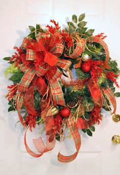 A lovely wreath, filled with ornaments and cascading plaid ribbon.
