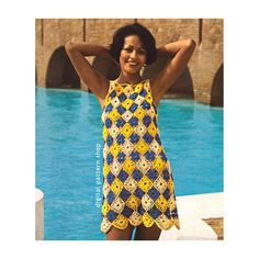 1970s Vintage Motif Tunic Dress Crochet Pattern: A tunic dress made up of a patchwork of lacy motifs in three bright colors. It would make a