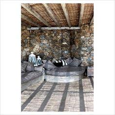 Stone patio under pergola.  GAP Interiors -  Picture library specialising in Interiors, Lifestyle & Homes