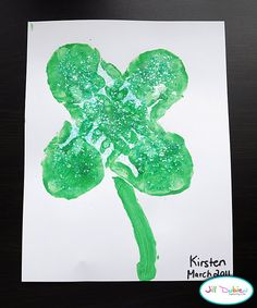 What you'll need:    green paint  paper  paint brush  optional - glitter and glue    Directions:    1. paint your child's palm green and have them stamp their hand, fingers pointing in and together, 4 times to resemble a shamrock.  2. paint on a green stem and allow to dry.  3. optinally, paint on some glue and sprinkle on some glitter for a really cool look.