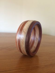 Handcrafted  Wood Bangle made from Jarrah , Rose Gum, Mahogany and Stringy-bark (Eucalyptus). Artist Signed. Sculptor Colin Watson by reborntimber on Etsy
