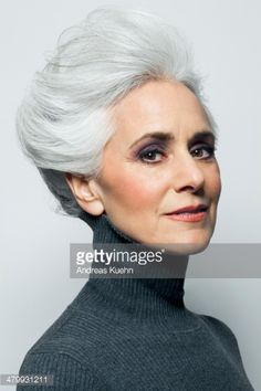 Stock Photo : Grey haired woman with updo, portrait.