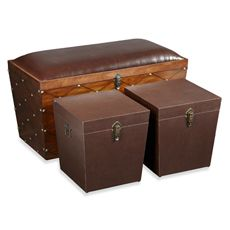 Bombay® Hermitage Storage Trunk - A handsome combination of utility and style, the Hermitage trunk boasts a trio of storage and comfy seating. Enjoy cushy seating for the larger size, secure odds and ends in the smaller cubes; and all are ideal for storing games, extra bedding and/or the odd pillow. Rich brown faux-leather upholstery and antique-brass nailhead trim accent this piece with exquisite charm.