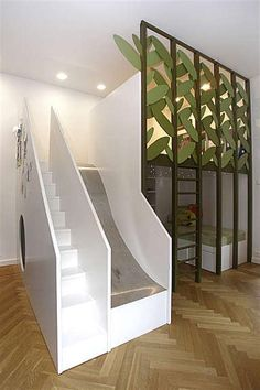 Kids room with stairs, slide and a bed on the bottom and top.
