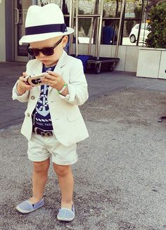 :) Cute little boy in a blazer and shorts with boat shoes and sunglasses on.