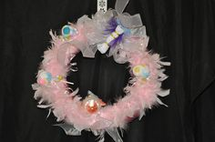 Special Baby Girl wreath! Includes four baby washcloth's, and a keepsake ornament.  Ornament is not dated so it can easily be added. One of Bette's Creations!
