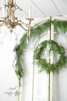 Christmas in the Cottage -  Sometimes simple Christmas touches are perfect.         A clipping of fresh greens across a window   pretty packages that add a pop of colo...