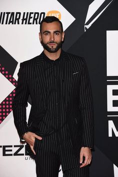Singer Marco Mengoni wore a Givenchy by Riccardo Tisci Fall Winter 2015 outfit to the MTV Europe Music Awards held on October 25th, 2015 at Mediolanum Forum in Milan, Italy.