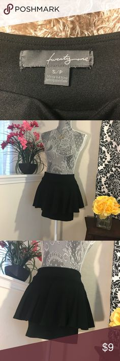 Twenty-one Black Straight/Peplum Combo Mini Skirt Stretchy and short. Tube skirt underneath, topped with an overlay of ruffles. Near new! Rayon/Poly/Spandex blend. Twenty-One Skirts Mini